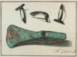 Hache de l'âge du Bronze et fibules romaines
